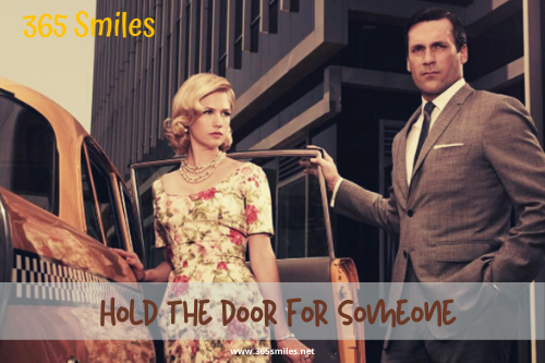 Hold the door for someone as act of kindness